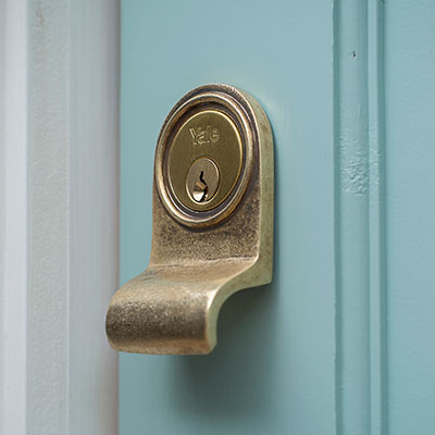 Yale Lock Surround in Antiqued Brass