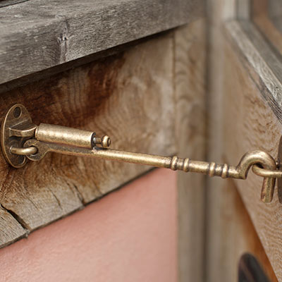 Newport Sprung Cabin Hook in Antiqued Brass