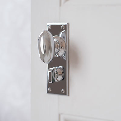 Downley Door Knob with Ripley Privacy Backplate