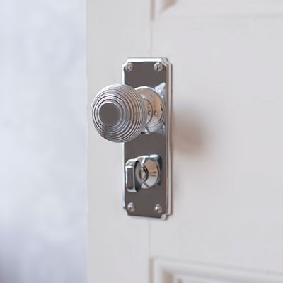 Reeded Door Knob with Ilkley Privacy Backplate