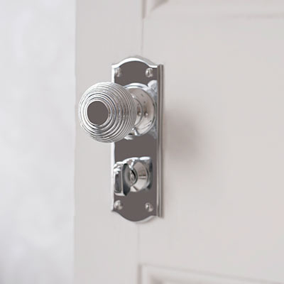 Reeded Door Knob with Nowton Privacy Backplate