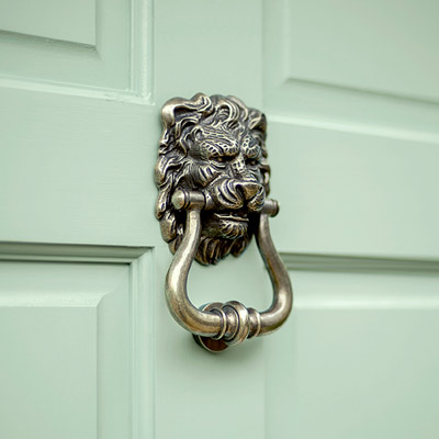Lion's Head Door Knocker in Antiqued Brass