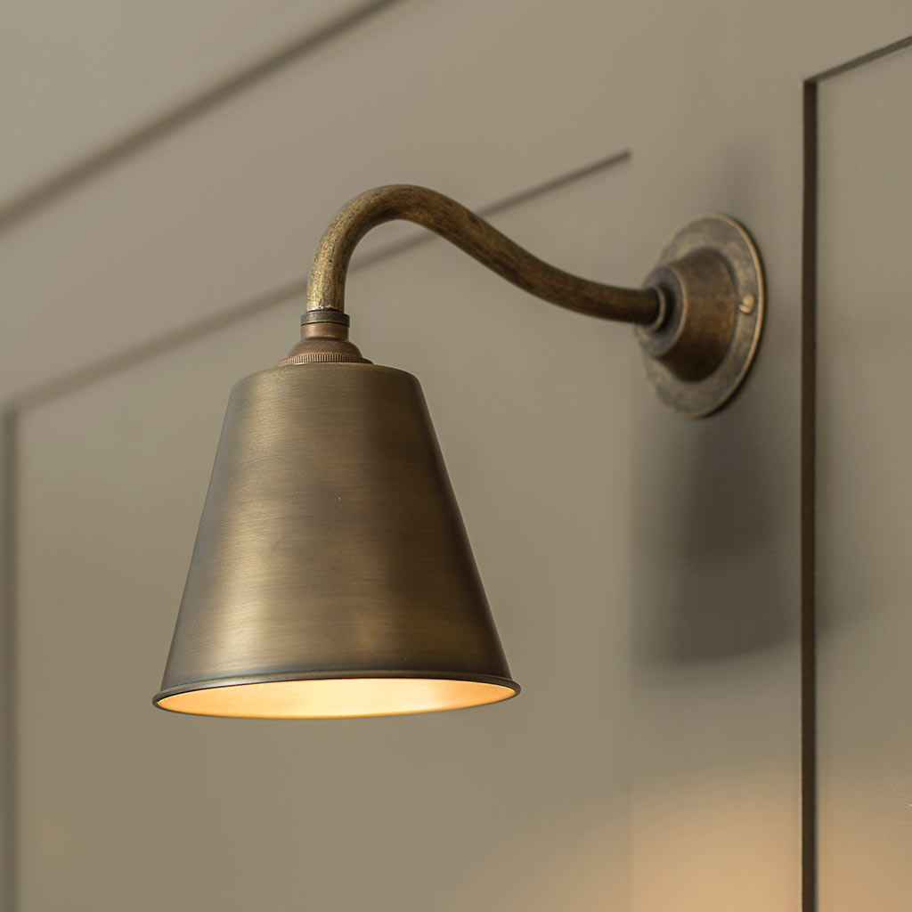 Club Wall Light in Antiqued Brass