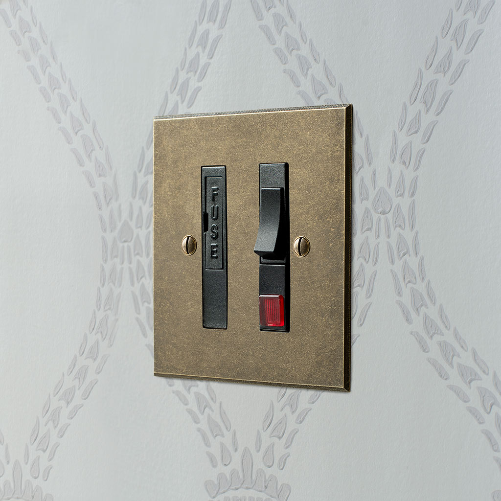 Fused Switch + Neon Antiqued Brass Bevelled Plate, Black Insert