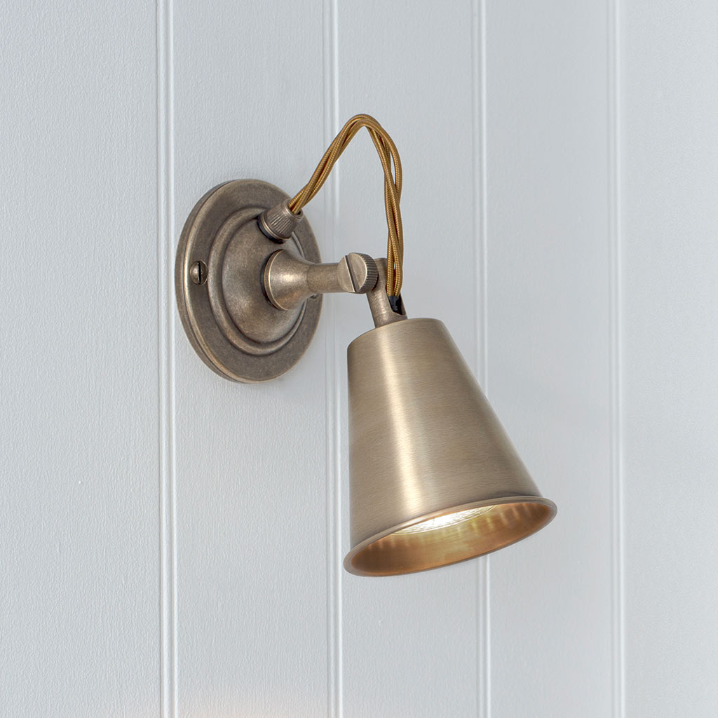 Single Curtis Spot Light in Antiqued Brass