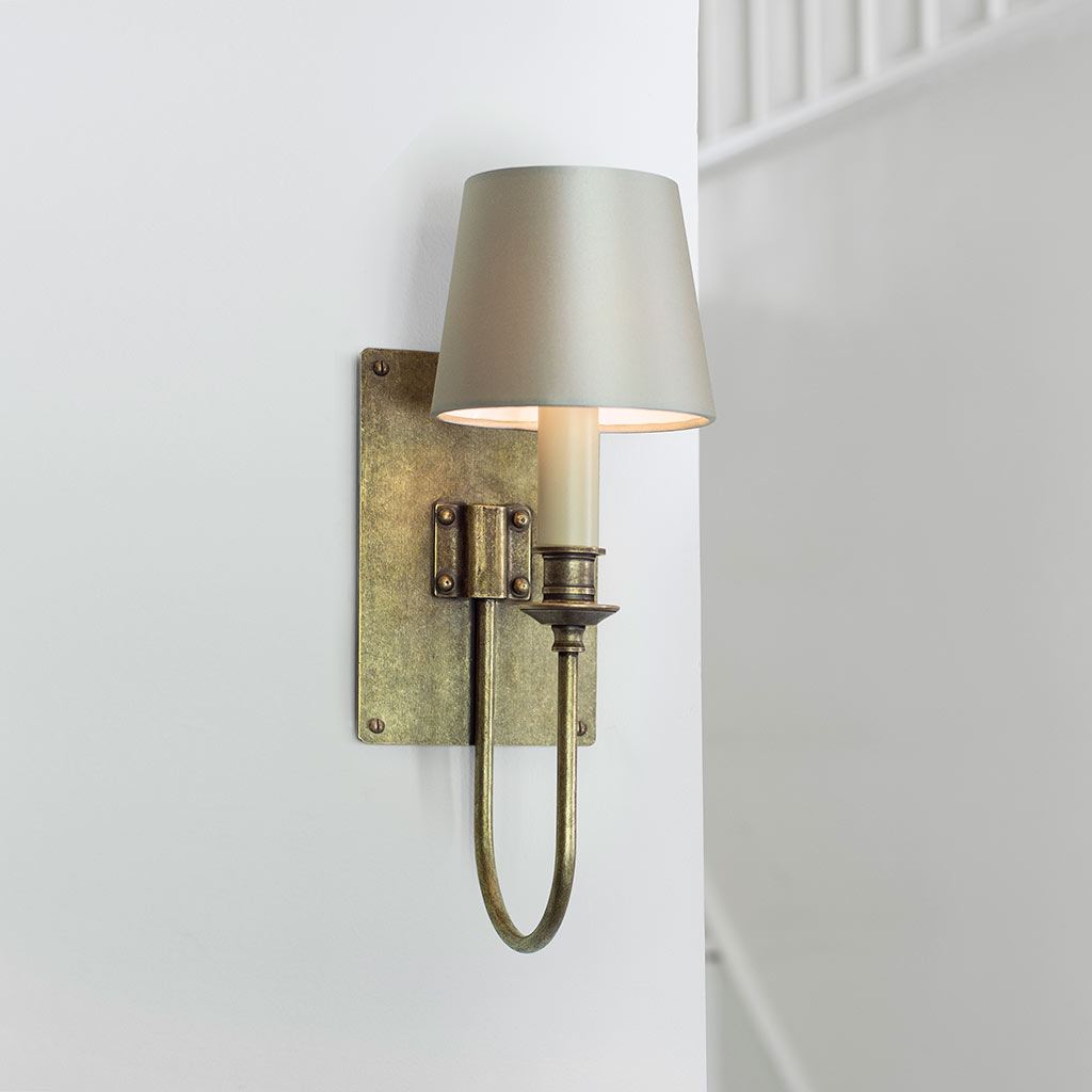 Single Station Wall Light in Antiqued Brass