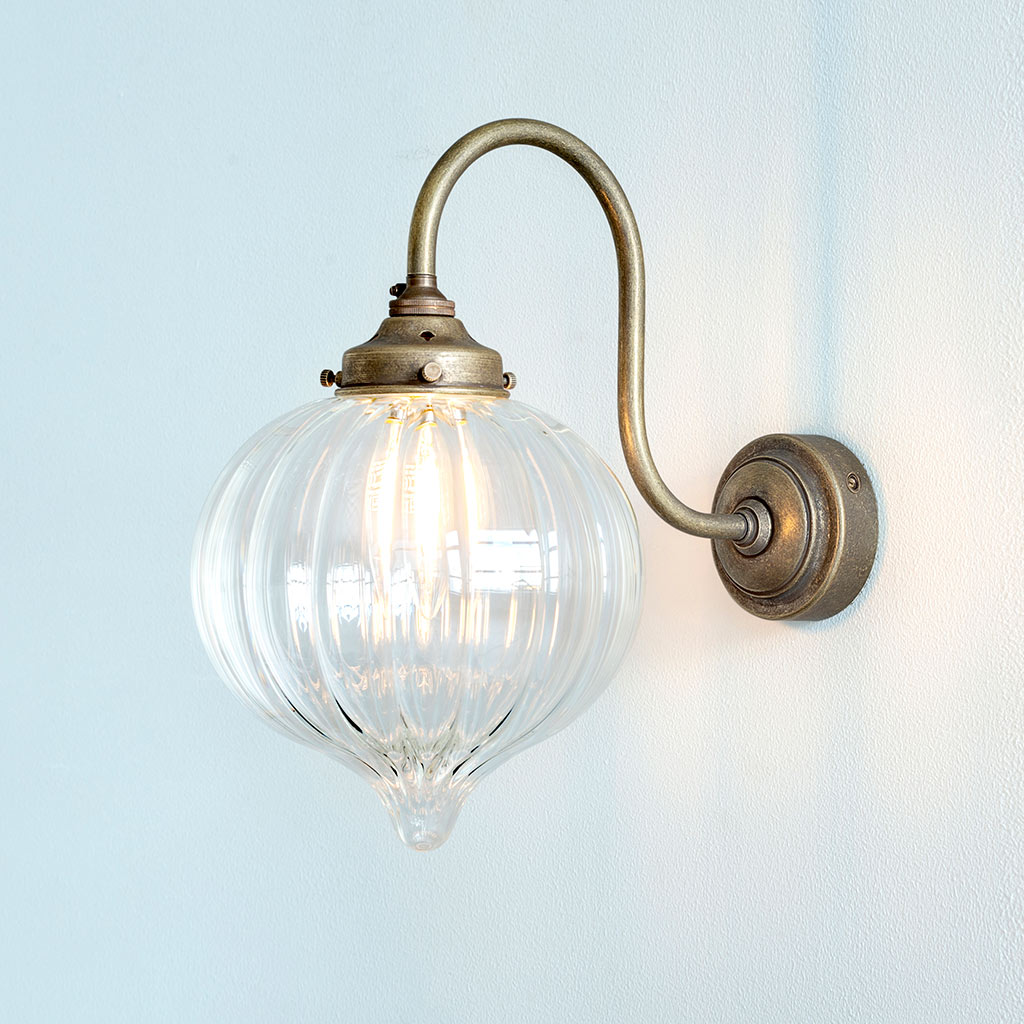 Mia Wall Light in Antiqued Brass