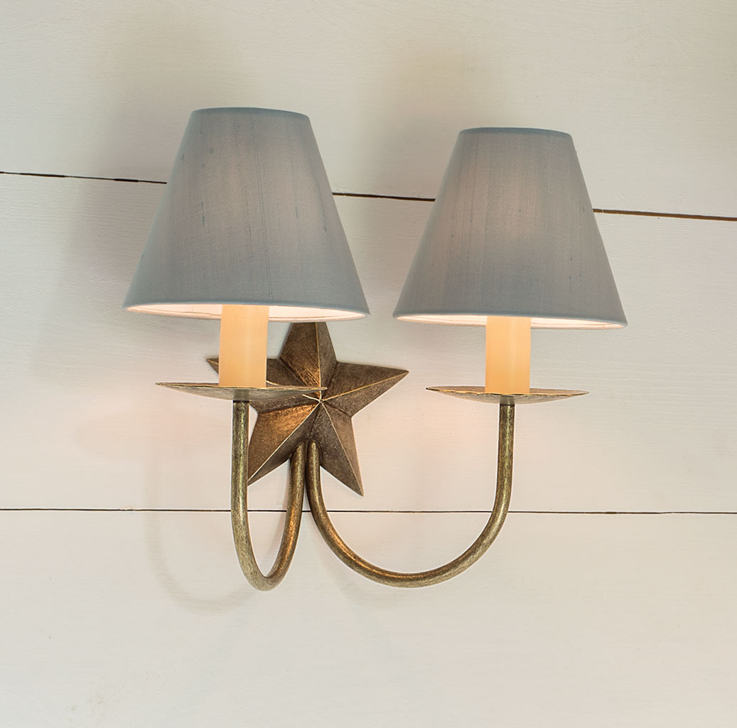 Double Star Wall Light in Antiqued Brass