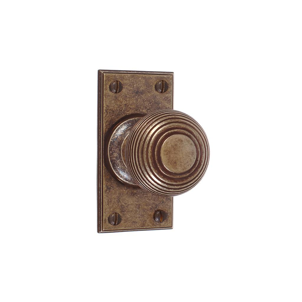 Reeded Door Knob, Ripley Short Plate, AntiquedBrass