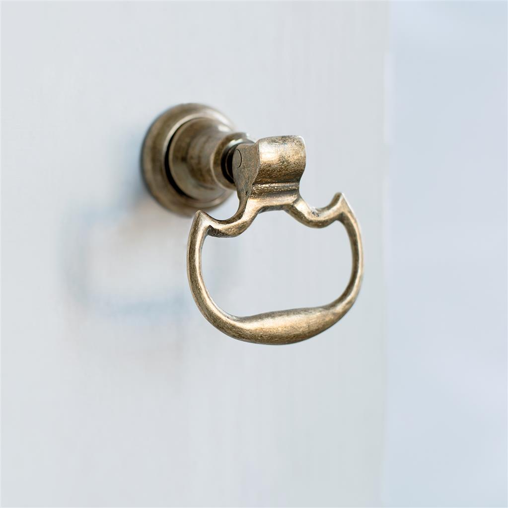 Mews Drop Handle in Antiqued Brass