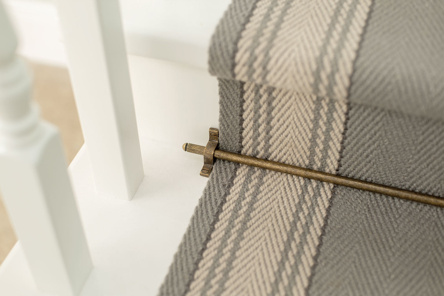 Turned Stair Rods in Antiqued Brass