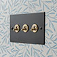 3 Gang Brass Dolly Switch Beeswax Bevelled Plate