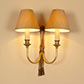 Ribbon Wall Light in Antiqued Brass